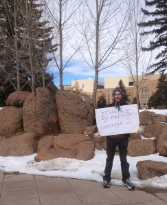 J.D. Wagner held a sign to brighten the day of students walking on campus today.